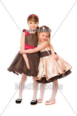 Two Cute Little Girls In A Dress. Stock Photo