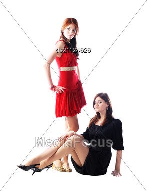 Two Cute Young Pretty Girls In Stylish Dresses Stock Photo