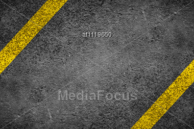 Two Diagonal Yellow Lines On The Asphalt Stock Photo