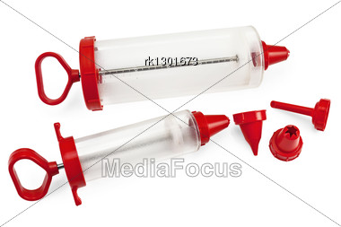 Two Different Sizes Of Confectionery Syringe With Replaceable Nozzles Stock Photo