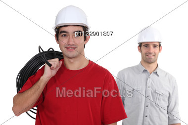 Two Electrician About To Start Work Stock Photo