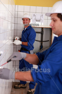 Two Electricians Working Stock Photo