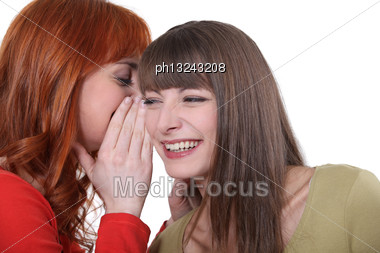 Two Friends Gossiping Stock Photo