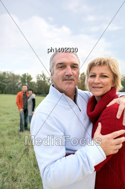 Two Generations Stood In Field Stock Photo