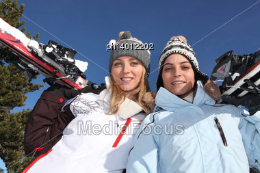 Two Girls With Skis Stock Photo