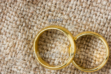 Two Golden Wedding Rings On The Burlap Stock Photo