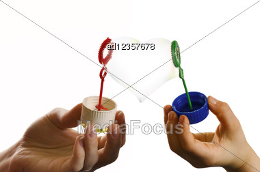 Two Hands Of Mother And Child With Heart Form Soap Bubble Stock Photo