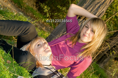 Two Happy Beauty Young Blonde Outdoors Stock Photo