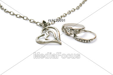 Two Heart Necklace And Two Rings Stock Photo