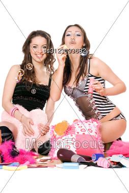 Two Joyful Girls Blow Bubbles. Stock Photo