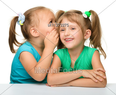 Two Little Girls Are Chatting, Stock Photo