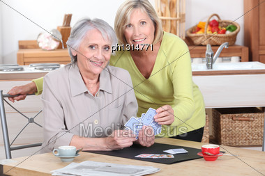 Two Mature Women Playing Cards Stock Photo