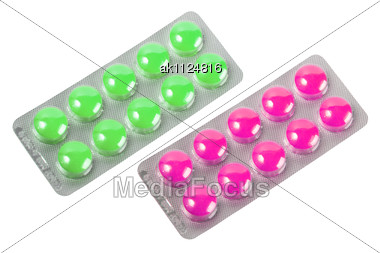 Two Metallic Blister With Purple And Green Pills Close-up Studio Photography Stock Photo