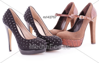 Two Pair Of Brown And Black Shoes Isolated On White Background Stock Photo