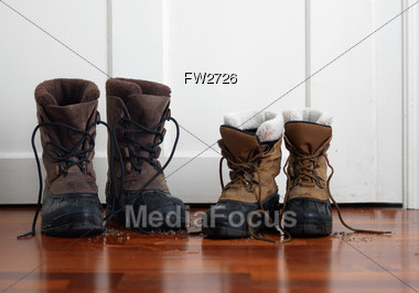Stock Photo Two Pairs Winter Boots Front Door Image