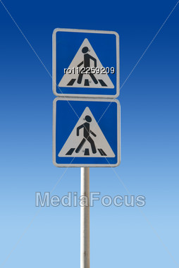 Two Pedestrian Sign On A Blue Background Stock Photo