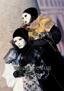 Two Performers Wearing Theater Masks Stock Photo