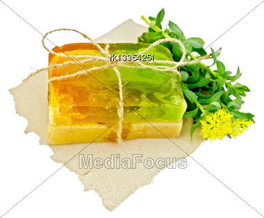 Two Pieces Of Homemade Soap, Tied With Twine With Rhodiola Rosea Flowers On A Piece Of Paper Isolated On White Background Stock Photo