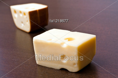 Two Pieces Of Cheese On The Table Stock Photo