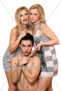 Two Playful Blonde And A Guy In Chains Stock Photo