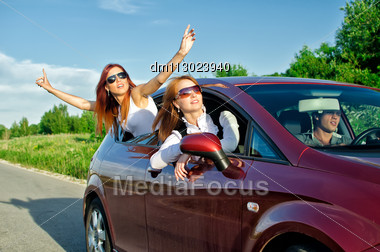 Two Pretty Happy Girls In The Car. Concept Of Carefree Roadtrip Stock Photo