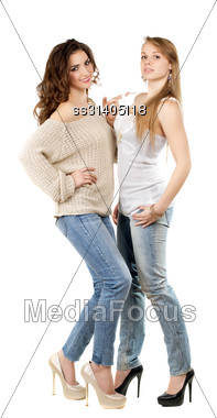 Two Pretty Women Wearing Blue Jeans And Heels. Isolated On White Stock Photo