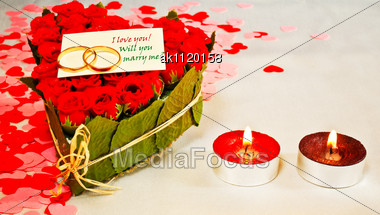 Two Rings And A Blank Card With Two Red Candles Stock Photo