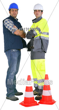 Two Road Workers Stood By Traffic Cones Stock Photo