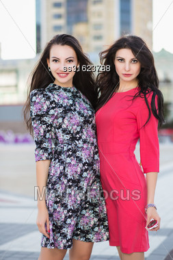 Two Sexy Women Wearing Dresses Posing Outdoors Stock Photo