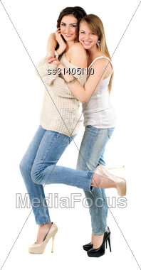 Two Smiling Caucasian Women Dressed In Casual Clothing. Isolated On White Stock Photo