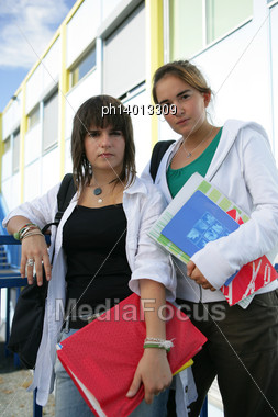 Two Teenage Girls Going To Their Next Lesson Stock Photo