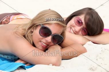Two Teenage Girls Sunbathing Stock Photo