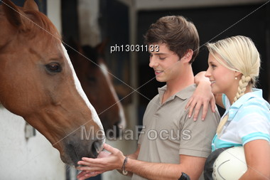 Two Teenagers Stood By Horse Stable Stock Photo