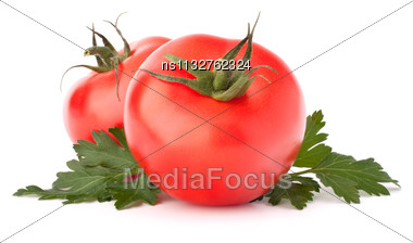 Two Tomato Vegetables And Parsley Leaves Still Life Isolated On White Background Cutout Stock Photo