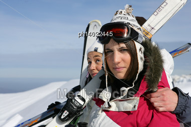 Two Woman Having A Good Time On Skiing Holiday Stock Photo