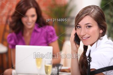 Two Women At Restaurant Stock Photo