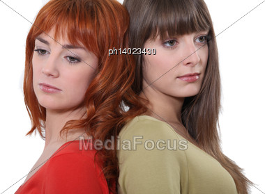 Two Women Back To Back Stock Photo