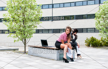 Two Women Have A Rest In City Park Stock Photo