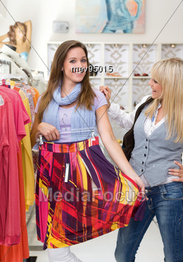 Two Women in a Boutique Clothes Shopping Stock Photo