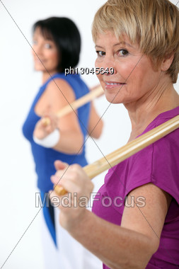 Two Women In Gym Class Stock Photo