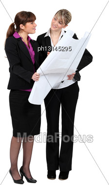Two Women Looking At Map Stock Photo
