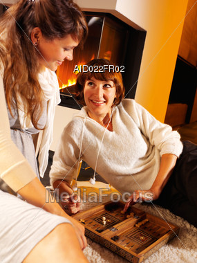 Two Women Playing Backgammon Stock Photo