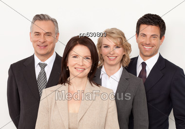 Two Women And Two Men In The Office, Smiling Stock Photo
