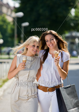 Royalty Free Stock Photo Two Women Walking With Ice Cream Cones