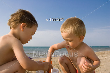Two Young Children On The Beach Stock Photo