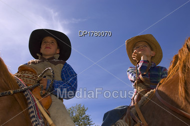 Two Young Cowboys Stock Photo