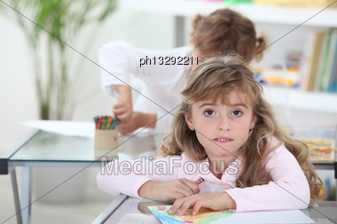 Two Young Girls In Class Stock Photo
