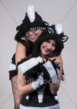 Two Young Ladies In A Skunk Costume Stock Photo