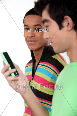 Two Young Men With Cellphone Stock Photo