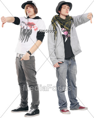 Two Young Teens Giving Thumbs Down Stock Photo